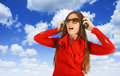 Girl listening music with sky in background Stock Photos