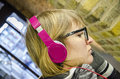 Girl listening to music pink headphones Royalty Free Stock Image