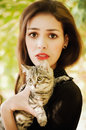 Girl with a little cat surprised Stock Photos