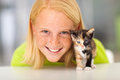 Girl little kitten beautiful teen with her pet Stock Images