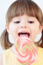Girl and a lollipop Royalty Free Stock Photo