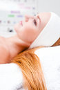Girl with long hair in spa clinic Stock Image