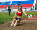 Girl long jumps Stock Image