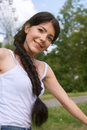 Girl with long plait pretty smiling in park Royalty Free Stock Photography