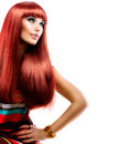 Girl with long red hair healthy straight fashion beauty model Royalty Free Stock Image