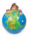 Girl look out of inflatable globe and embracing it Royalty Free Stock Images