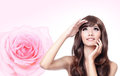 Girl look up forward with smile and pink rose Stock Photo