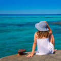 Girl looking at beach in formentera turquoise mediterranean sea background Stock Image