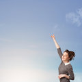 Girl looking at the blue sky copyspace concept Royalty Free Stock Photos