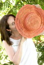 Girl looking out  from a summer hat Stock Images