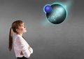 Girl looking at a planet Royalty Free Stock Photo