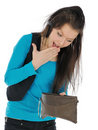 Girl looking into purse. Stock Photography