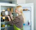 Girl looking for something in fridge Royalty Free Stock Photo