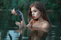 Girl looks at the fish. Royalty Free Stock Photo