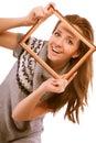 Girl looks through framework Royalty Free Stock Photo