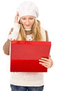 Girl looks in a gift box and wondering Royalty Free Stock Photo