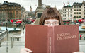 Girl looks over English Dictionary and square Royalty Free Stock Photo