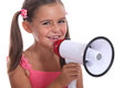 Girl with loud speaker to her mouth Royalty Free Stock Photo