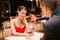Girl in love with boyfriends beautiful restaurant he pouring wine her glass Stock Images