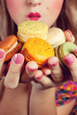 Girl Loves Colorful Macaroons Stock Image