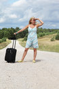 Girl with luggage Stock Photo