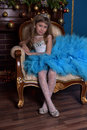 Girl with lush blue dress Royalty Free Stock Photo