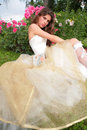 Girl in luxurious gown near rosebush Royalty Free Stock Photos