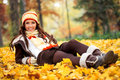 Girl lying autumn park smiling on leaves Royalty Free Stock Photography