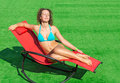 Girl lying in a deck chair with his eyes closed beautiful Stock Image