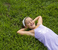 Girl lying in grass Royalty Free Stock Photos