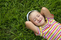Girl lying in grass Stock Photos