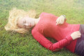 Girl lying on the grass young with long blond hair Stock Photo