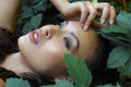 Girl lying in the green foliage Royalty Free Stock Photo