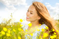 Girl lying on green grass beauty in the meadow with wild flowers Stock Photo