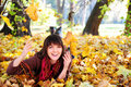 Girl lying in leaves. Royalty Free Stock Image