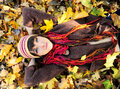 Girl lying in leaves. Stock Photos