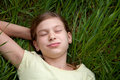 Girl lying on a meadow in nature portrait of young Royalty Free Stock Photos
