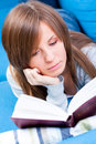 Girl lying and reading book Royalty Free Stock Photo
