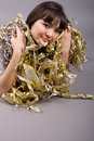 Girl lying among tinsel Stock Photo