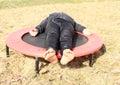 Image : Girl lying on trampoline   face