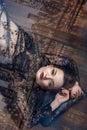 Girl lying upside down on the floor. Royalty Free Stock Photo