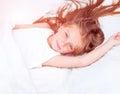 Girl lying in white bed