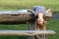 Girl lying on wooden table Royalty Free Stock Photo