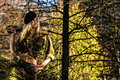Girl and machete beautiful on camouflage outfit with on forest Royalty Free Stock Photo