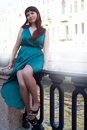 Girl with magnificent curvy shape shows off its legs under long evening dresses 8 Royalty Free Stock Photo