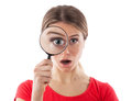 Girl with a magnifying glass Stock Photography