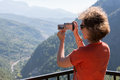 A girl make a photo on the camera a beautiful view of mountains and hills Stock Image
