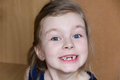 Girl makes faces cute beautiful toothless Stock Photography