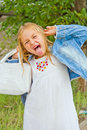 Girl makes faces imitate witch cute beautiful Royalty Free Stock Image