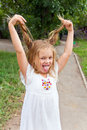 Girl makes faces imitate witch cute beautiful Royalty Free Stock Photo